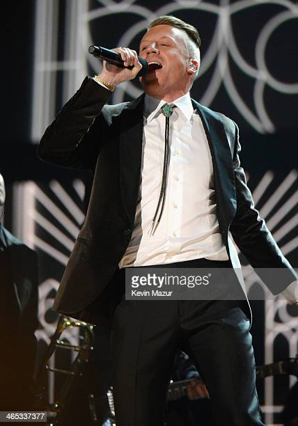Recording artist Macklemore performs onstage during the 56th GRAMMY Awards at Staples Center on January 26 2014 in Los Angeles California
