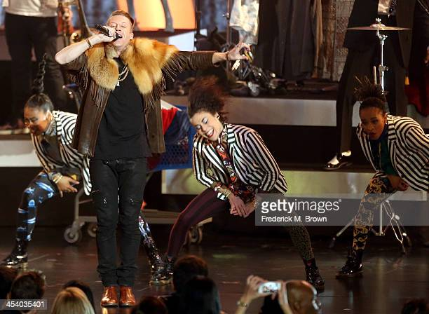 Recording artist Macklemore performs onstage during The GRAMMY Nominations Concert Live Countdown To Music's Biggest Night at Nokia Theatre LA Live...