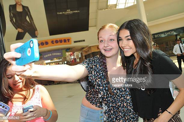 Recording artist Madison Beer poses with a fan during the MAC Cosmetics Orlando Store Opening at MAC Cosmetics Store at The Florida Mall on August 7...