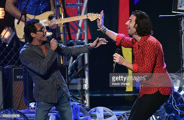 Recording artist Marc Anthony and music group Magic singer Nasri perform onstage during the 15th annual Latin GRAMMY Awards at the MGM Grand Garden...