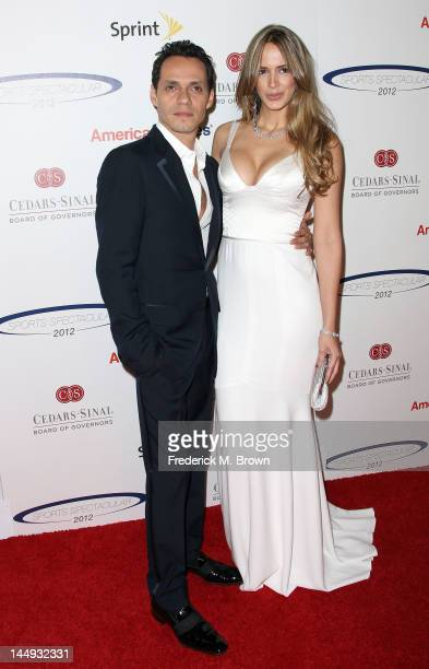 Recording artist Marc Anthony and Shannon De Lima attend the 27th Annual CedarsSinai Medical Center Sports Spectacular at the Hyatt Regency Century...