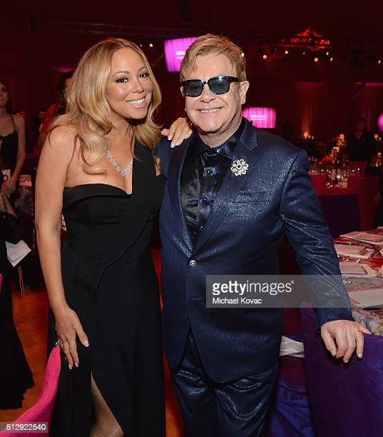 Recording artist Mariah Carey and host Sir Elton John attend the 24th Annual Elton John AIDS Foundation's Oscar Viewing Party at The City of West...