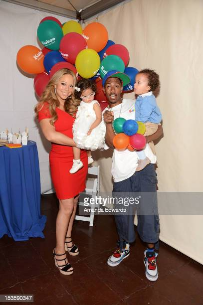Recording artist Mariah Carey her husband Nick Cannon and their twins Monroe Cannon and Moroccan Cannon attend Family Day hosted by Nick Cannon at...