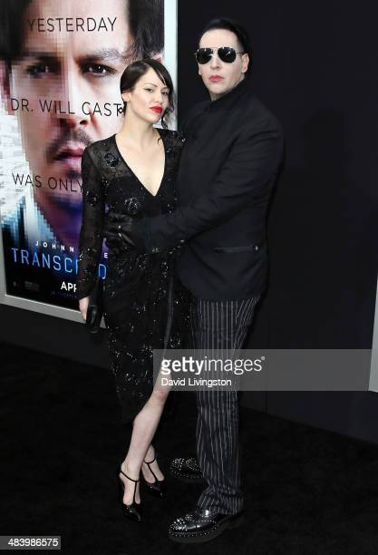 Recording artist Marilyn Manson and Lindsay Usich attend the premiere of Warner Bros Pictures and Alcon Entertainment's Transcendence at the Regency...