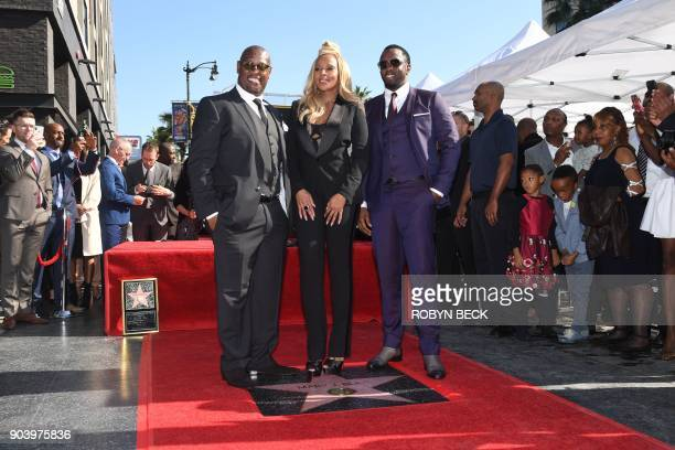 Recording artist Mary J Blige is joined by music producers Andre Harrell and Sean 'Diddy' Combs as she is honored with a star on the Hollywood Walk...
