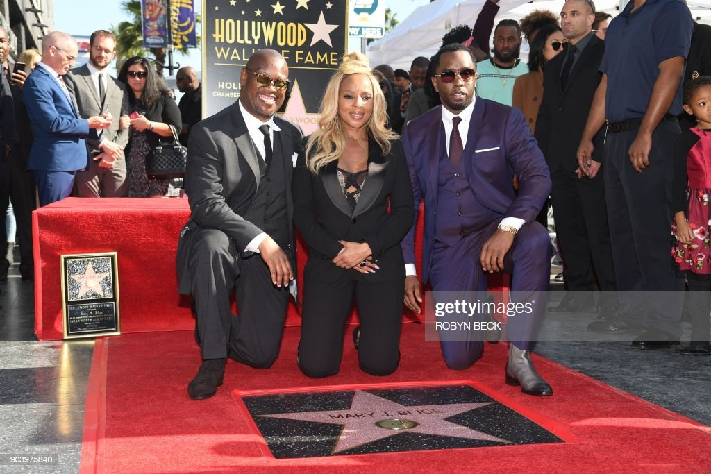 Recording artist Mary J. Blige is joined by music producers Andre Harrell (L) and Sean 'Diddy' Combs (R) as she is honored with a star on the Hollywood Walk of Fame, January 11, 2018 in Hollywood, California. The Grammy Award-winning artist is nominated for 2018 Golden Globe, Screen Actors Guild and Critic's Choice Awards for her performance in the Netflix film 'Mudbound.' / AFP PHOTO / Robyn Beck
