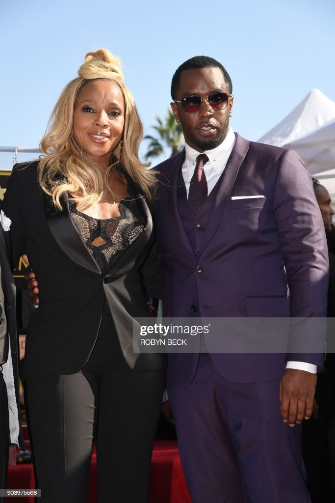 Recording artist Mary J. Blige (L) is joined by Sean 'Diddy' Combs as she is honored with a star on the Hollywood Walk of Fame, January 11, 2018 in Hollywood, California. The Grammy Award-winning artist is nominated for the 2018 Golden Globe, Screen Actors Guild and Critic's Choice Awards for her performance in the Netflix film 'Mudbound.' / AFP PHOTO / Robyn Beck
