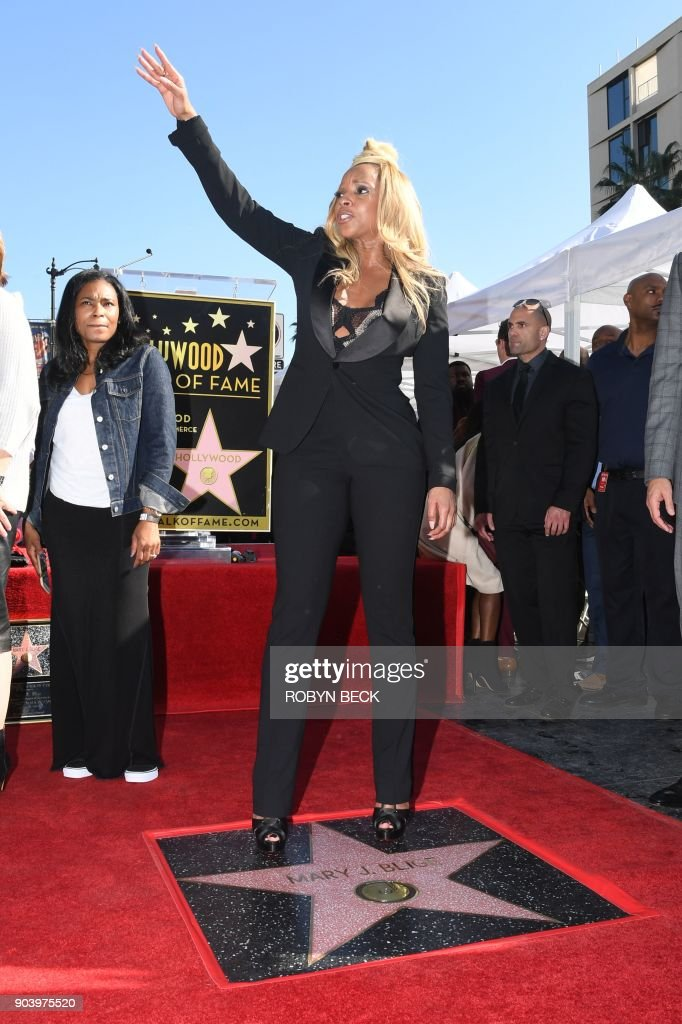 Recording artist Mary J. Blige poses with her star on the Hollywood Walk of Fame, January 11, 2018 in Hollywood, California. The Grammy Award-winning artist is nominated for the 2018 Golden Globe, Screen Actors Guild and Critic's Choice Awards for her performance in the Netflix film 'Mudbound.' / AFP PHOTO / Robyn Beck