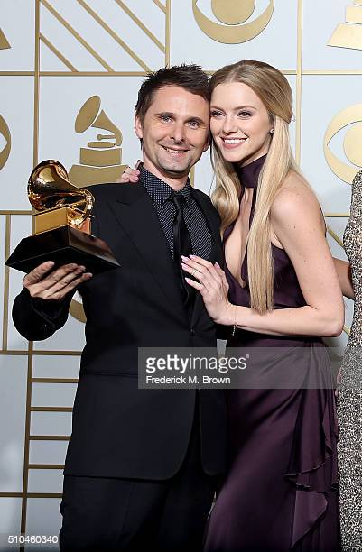 Recording artist Matt Bellamy of music group Muse winner of Best Rock Album for 'Drones' and model Elle Evans pose in the press room during The 58th...