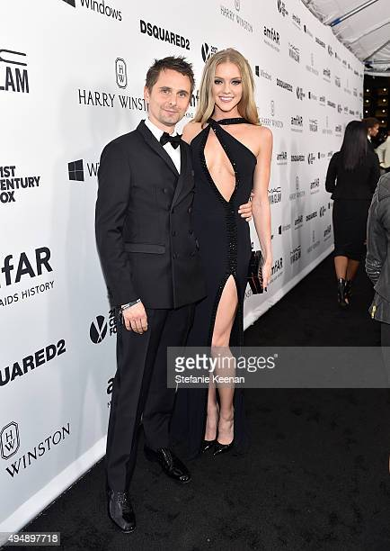 Recording artist Matthew Bellamy of Muse and model Elle Evans and Harry Winston at amfAR's Inspiration Gala Los Angeles at Milk Studios on October 29...