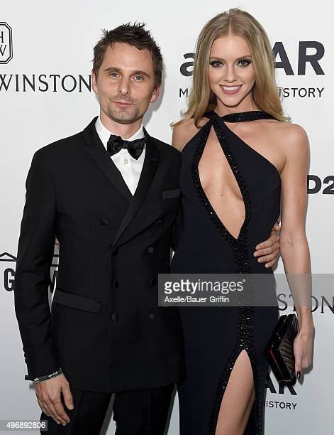 Recording artist Matthew Bellamy of Muse and model Elle Evans arrive at amfAR's Inspiration Gala Los Angeles at Milk Studios on October 29 2015 in...