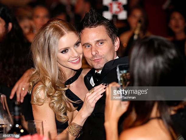 Recording artist Matthew Bellamy of Muse and model Elle Evans attend the amfAR Inspiration Gala at Milk Studios on October 29 2015 in Hollywood...