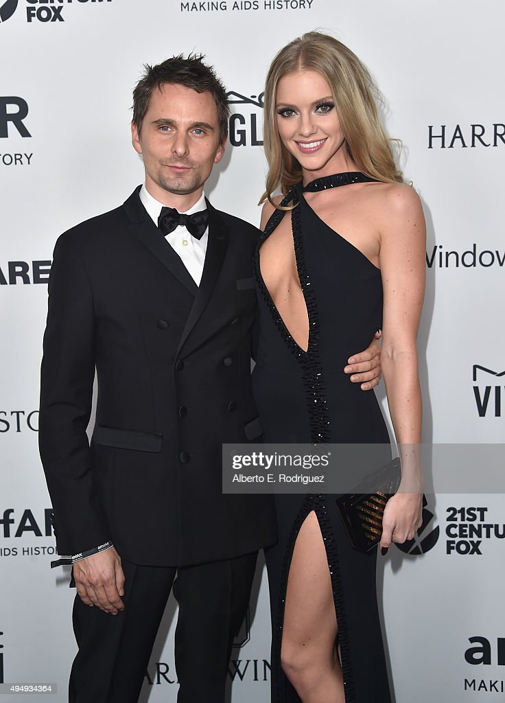 Recording artist Matthew Bellamy of Muse (L )model Elle Evans attends amfAR's Inspiration Gala Los Angeles at Milk Studios on October 29, 2015 in Hollywood, California.
