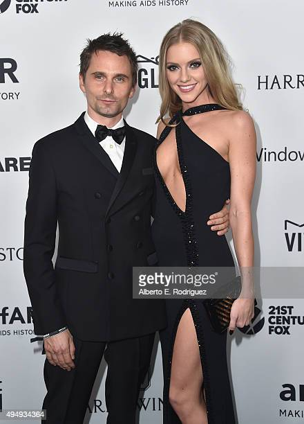 Recording artist Matthew Bellamy of Muse model Elle Evans attends amfAR's Inspiration Gala Los Angeles at Milk Studios on October 29 2015 in...
