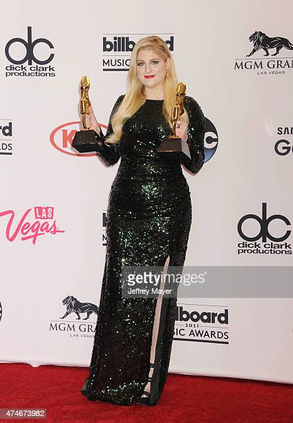 Recording artist Meghan Trainor winner of Top Hot 100 Song for 'All About That Bass' and Top Digital Song for 'All About That Bass' poses in the...