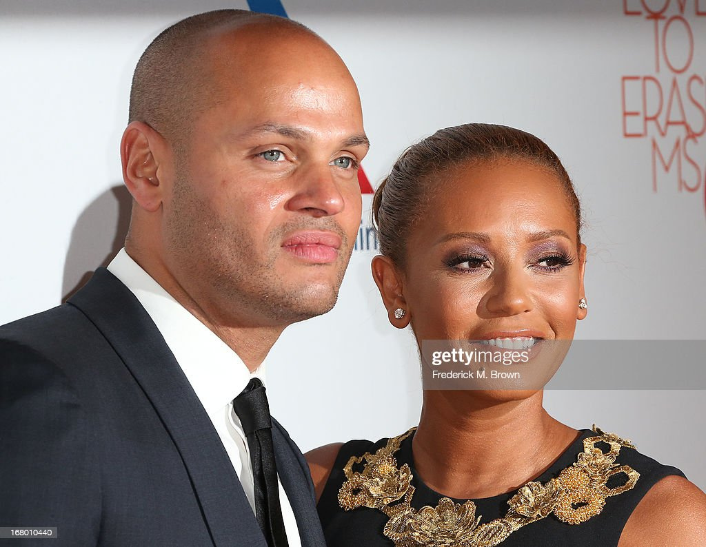 Recording artist Melanie Brown (R) and her guest attend the 20th Annual Race to Erase MS Gala 'Love to Erase MS' at the Hyatt Regency Century Plaza on May 3, 2013 in Century City, California.