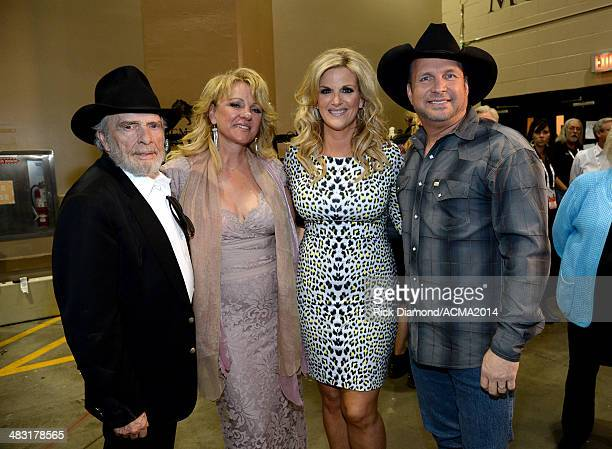 Recording artist Merle Haggard Theresa Ann Lane recording artist Trisha Yearwood and recording artist Garth Brooks attend the 49th Annual Academy of...