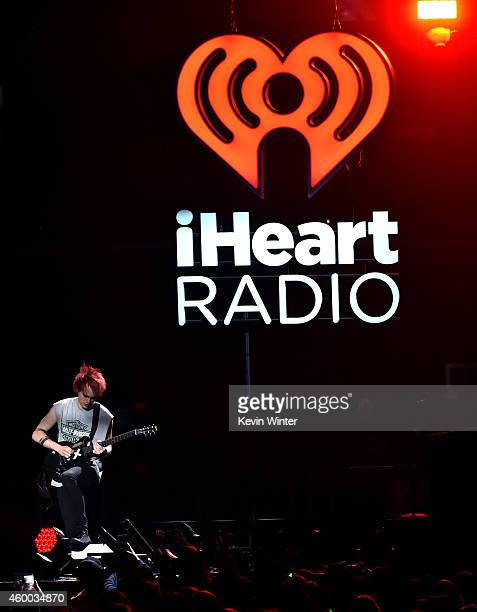 Recording artist Michael Clifford of music group 5 Seconds of Summer performs onstage during KIIS FM's Jingle Ball 2014 powered by LINE at Staples...