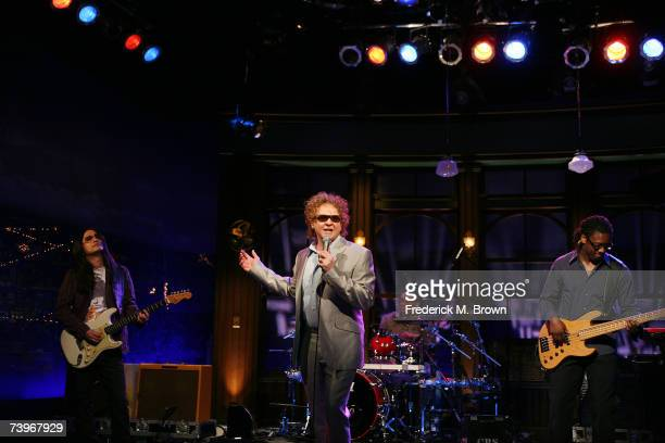 Recording artist Mick Hucknall of Simply Red performs during a segment of The Late Late Show with Craig Ferguson at CBS Television City on April 24...