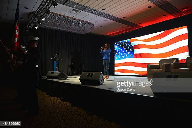 Recording artist Mickey Guyton performs during the Opening Ceremonies of CRS 2015 on February 25 2015 at the Nashville Convention Center in Nashville...