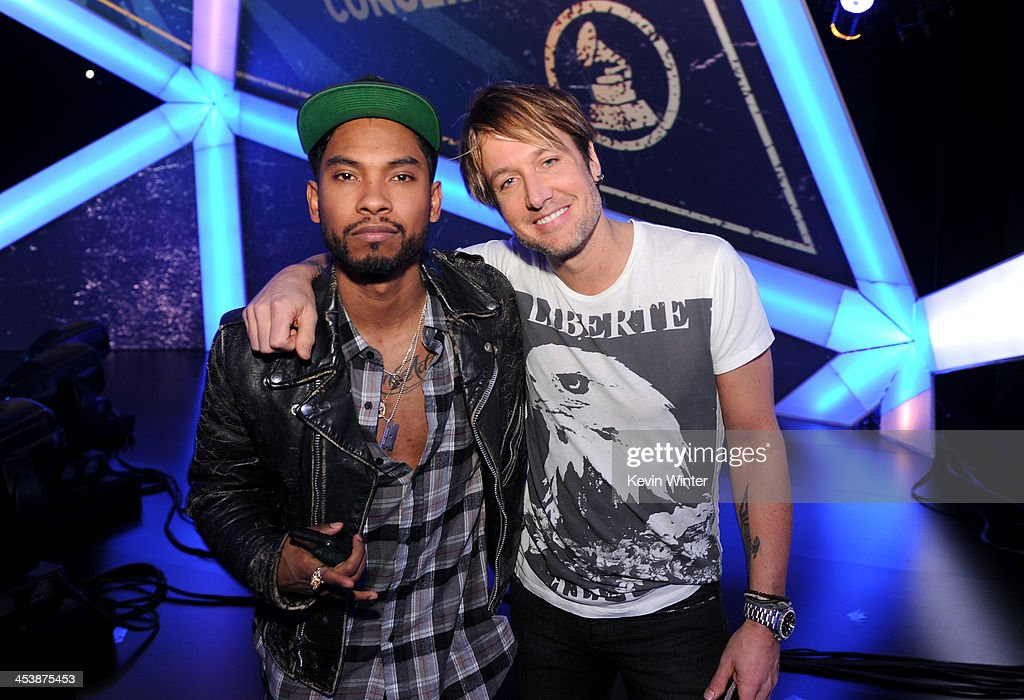 Recording artist Miguel (L) and Keith Urban pose onstage during the rehearsals for The GRAMMY Nominations Concert Live!! Countdown to Music's Biggest Night at Nokia Theatre L.A. Live on December 5, 2013 in Los Angeles, California.