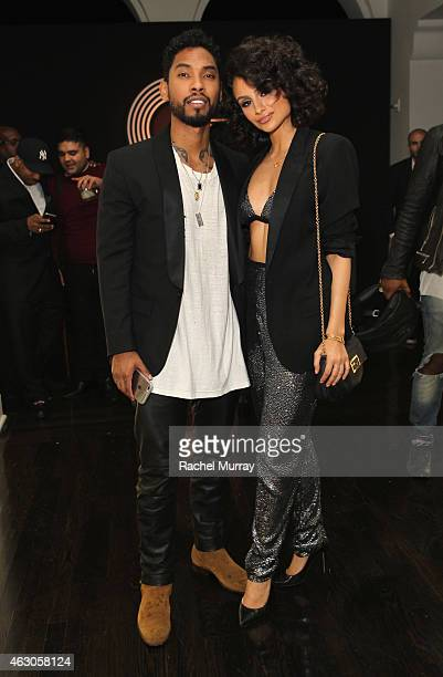 Recording artist Miguel and Nazanin Mandi attend GQ and Giorgio Armani Grammys After Party at Hollywood Athletic Club on February 8 2015 in Hollywood...