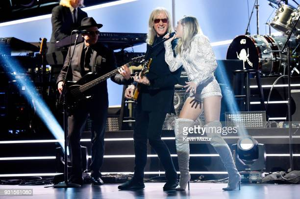 Recording artist Miley Cyrus and guitarist Davey Johnstone perform onstage during 60th Annual GRAMMY Awards I'm Still Standing A GRAMMY Salute To...