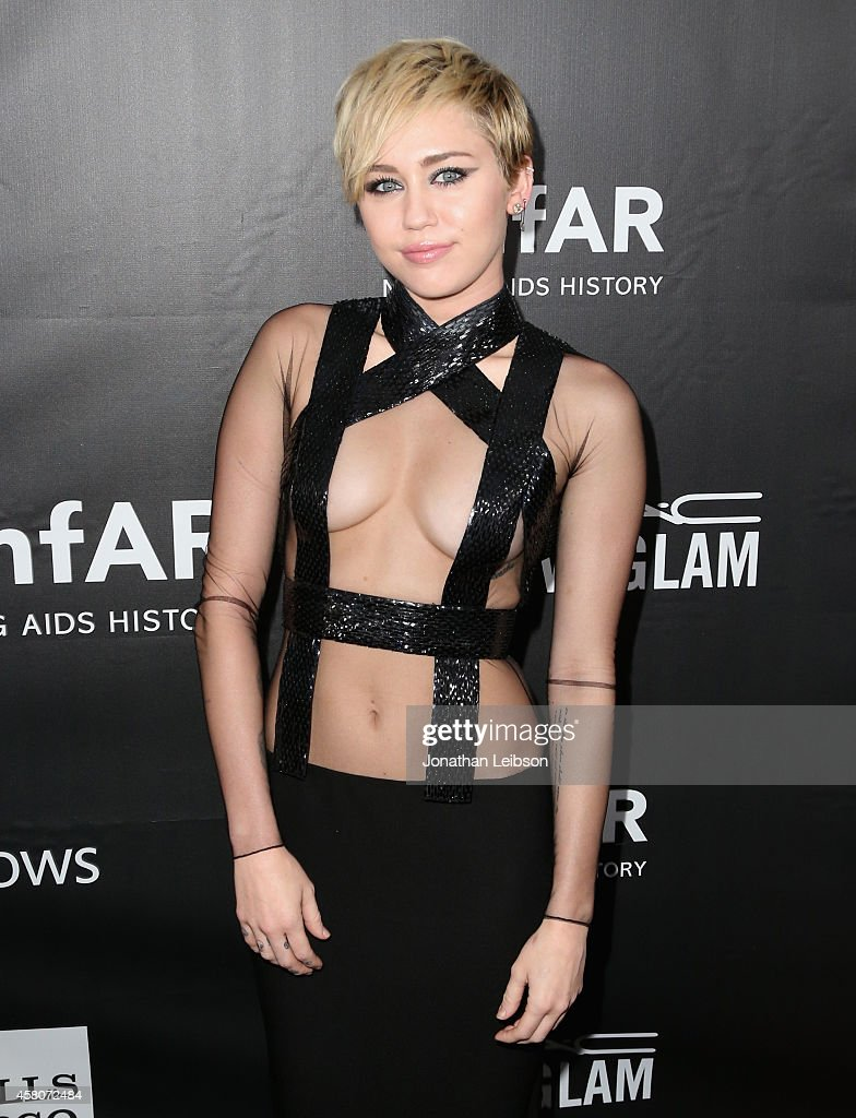 Recording artist Miley Cyrus attends amfAR LA Inspiration Gala honoring Tom Ford at Milk Studios on October 29, 2014 in Hollywood, California.