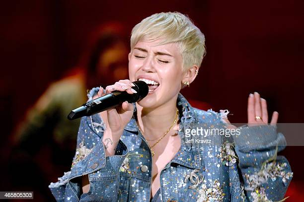 Recording artist Miley Cyrus performs onstage during Miley Cyrus MTV Unplugged at Sunset Gower Studios on January 28 2014 in Hollywood California