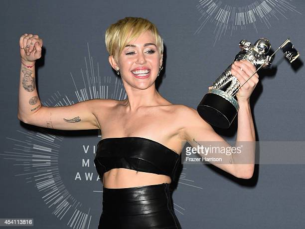 Recording Artist Miley Cyrus winner of Video of the Year award for 'Wrecking Ball' poses in the press room during the 2014 MTV Video Music Awards at...