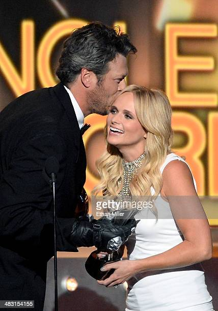 Recording artist Miranda Lambert accepts the Single Record of the Year award for 'Mama's Broken Heart' onstage from cohost Blake Shelton during the...
