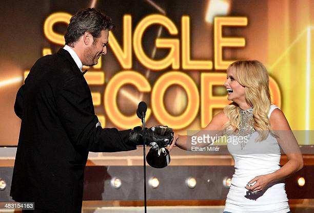 Recording artist Miranda Lambert accepts the Single Record of the Year award for 'Mama's Broken Heart' onstage from co=host Blake Shelton during the...