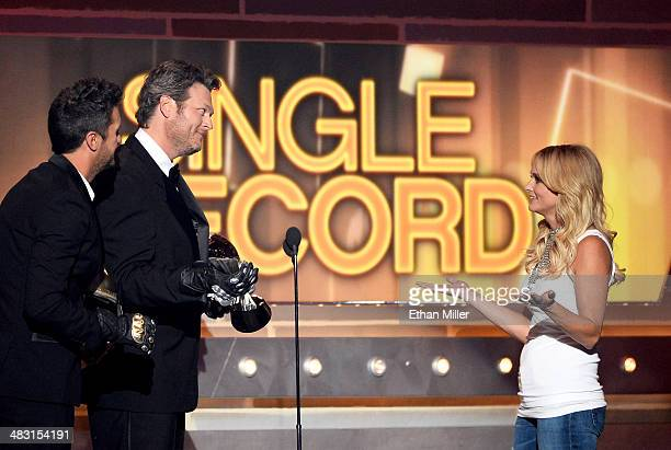 Recording artist Miranda Lambert accepts the Single Record of the Year award for 'Mama's Broken Heart' onstage from co-hosts Luke Bryan and Blake...