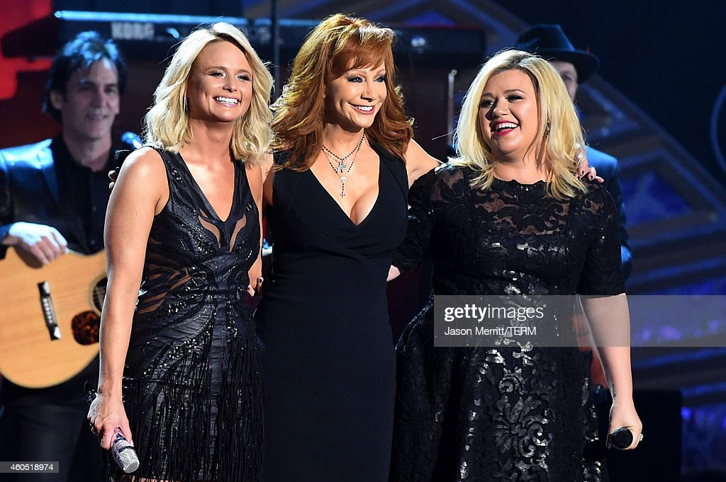 Recording artist Miranda Lambert, honoree Reba McEntire and recording artist Kelly Clarkson perform onstage during the 2014 American Country Countdown Awards at Music City Center on December 15, 2014 in Nashville, Tennessee.
