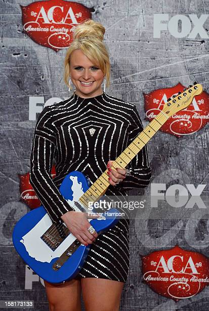 Recording artist Miranda Lambert poses in the press room with her award for Female Single of the Year during the 2012 American Country Awards at the...