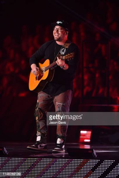Recording Artist Mitchell Tenpenny performs on stage during the 2019 CMT Music Awards Show at Bridgestone Arena on June 5 2019 in Nashville Tennessee