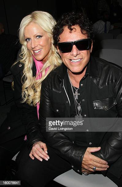 Recording artist Neal Schon and Michaele Salahi attend the 2013 NAMM Show Day 2 at the Anaheim Convention Center on January 25 2013 in Anaheim...