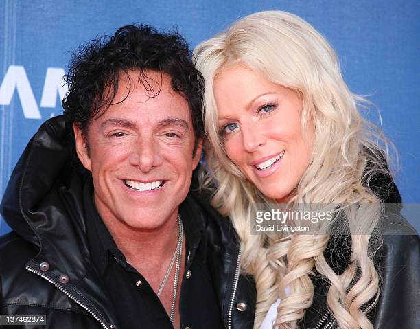 Recording artist Neal Schon of Journey and TV personality Michaele Salahi attend the 110th NAMM Show Day 2 at the Anaheim Convention Center on...