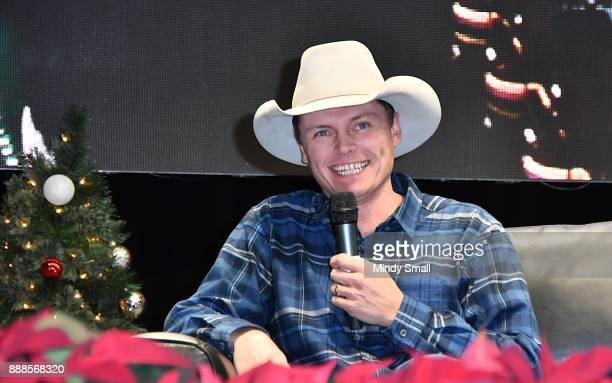 Recording artist Ned LeDoux speaks onstage during the Outside the Barrel with Flint Rasmussen show during the National Finals Rodeo's Cowboy...
