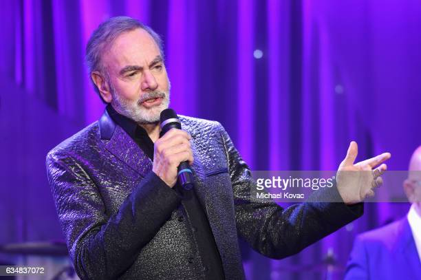 Recording artist Neil Diamond performs onstage at PreGRAMMY Gala and Salute to Industry Icons Honoring Debra Lee at The Beverly Hilton on February 11...