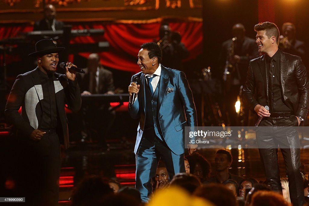 Recording artist Ne-Yo, Smokey Robinson and Robin Thicke perform on stage at the 2015 BET Awards on June 28, 2015 in Los Angeles, California.