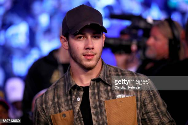 Recording artist Nick Jonas attends the super welterweight boxing match between Floyd Mayweather Jr and Conor McGregor on August 26 2017 at TMobile...
