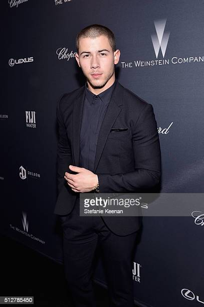 Recording artist Nick Jonas attends The Weinstein Company's PreOscar Dinner presented in partnership with FIJI Water Chopard DeLeon and Lexus at the...
