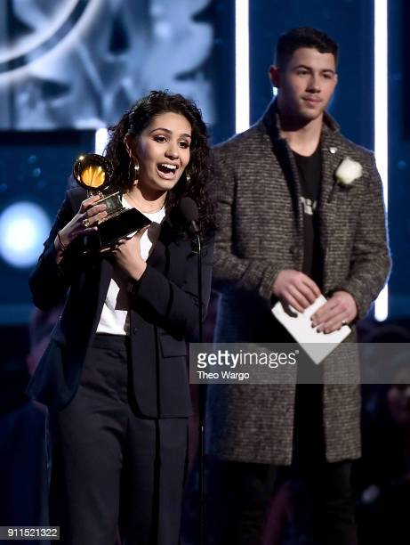 Recording artist Nick Jonas listens as recording artist Alessia Cara accepts the Best New Artist award onstage during the 60th Annual GRAMMY Awards...