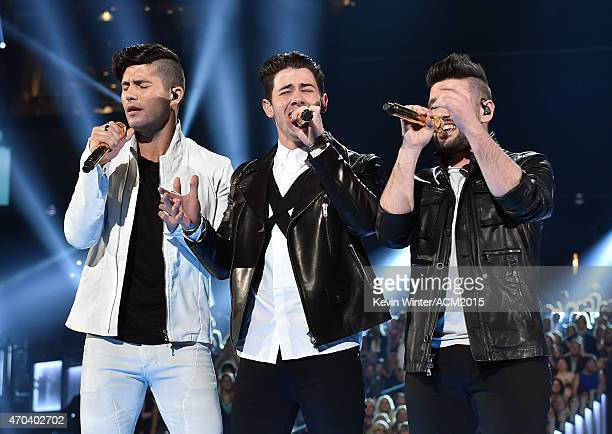 Recording artist Nick Jonas performs with Dan Smyers and Shay Mooney of Dan Shay onstage during the 50th Academy of Country Music Awards at ATT...