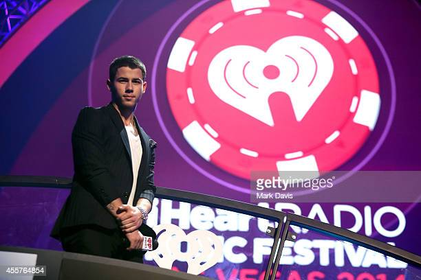 Recording artist Nick Jonas speaks onstage during the 2014 iHeartRadio Music Festival at the MGM Grand Garden Arena on September 19, 2014 in Las...