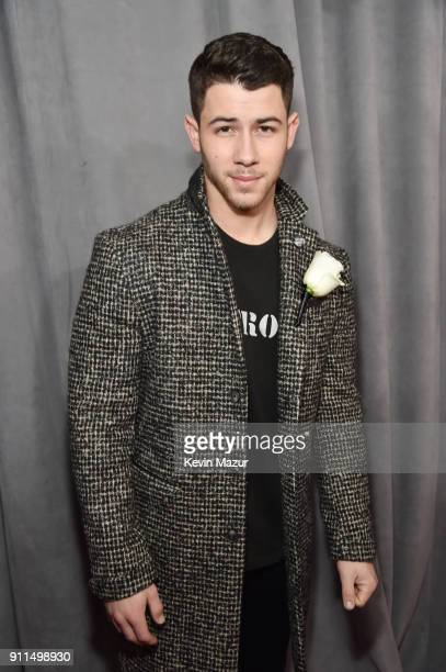 Recording artist Nick Jonas white rose detail attends the 60th Annual GRAMMY Awards at Madison Square Garden on January 28 2018 in New York City