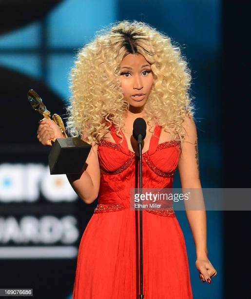 Recording artist Nicki Minaj accepts the awrd for Top Rap Artist onstage during the 2013 Billboard Music Awards at the MGM Grand Garden Arena on May...