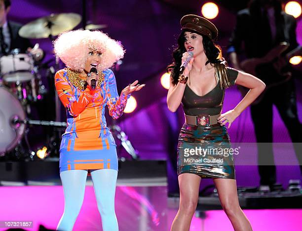 Recording artist Nicki Minaj and singer Katy Perry perform onstage during VH1 Divas Salute the Troops presented by the USO at the MCAS Miramar on...