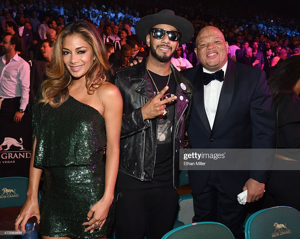 Recording artist Nicole Scherzinger, recording artist/producer Swizz Beatz and Shawn 'Pecas' Costner pose ringside at 'Mayweather VS Pacquiao' presented by SHOWTIME PPV And HBO PPV at MGM Grand Garden Arena on May 2, 2015 in Las Vegas, Nevada.
